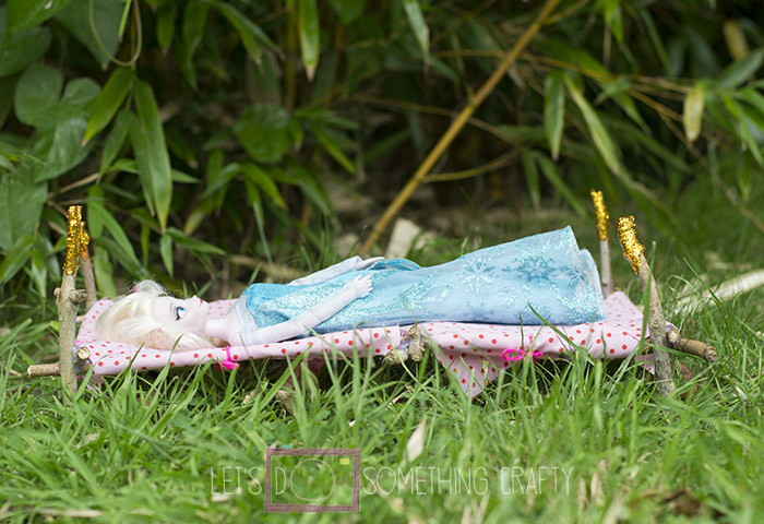 outdoor activities - making a dolls bed from sticks
