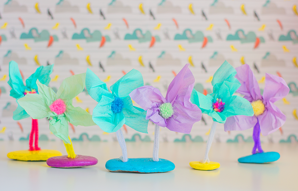 pretend flowers made from tissue paper and pom poms