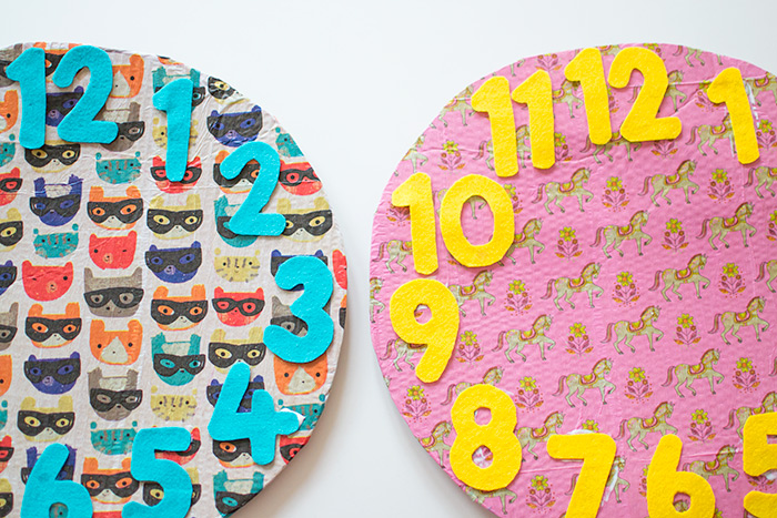 Telling the time with a cardboard diy clock for Large cardboard cut out numbers